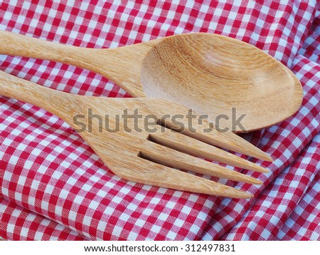 Wooden kitchen spoon on a red and white napkin