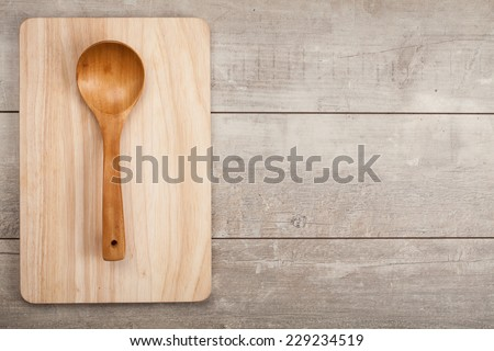 Wooden kitchen spoon on wood table