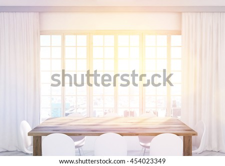 Wooden kitchen table and white chairs in front of window with curtains and New York city view. Toned image. 3D Rendering - stock photo
