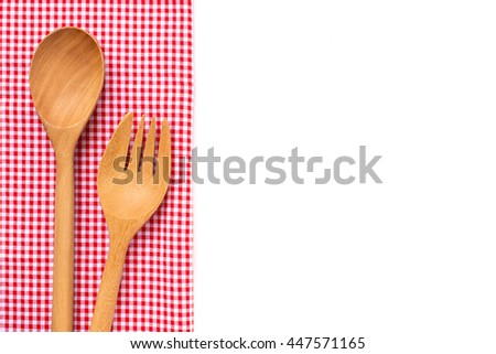 Wooden kitchen utensils and red checkered cotton kitchen towels tartan on white tabletop.  - stock photo