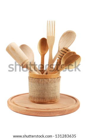 Wooden kitchen utensils isolated on white background. - stock photo