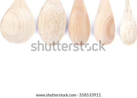 Wooden kitchen utensils isolated on white background, stock photo
