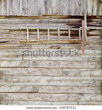 wooden ladder on the plank wall background - stock photo