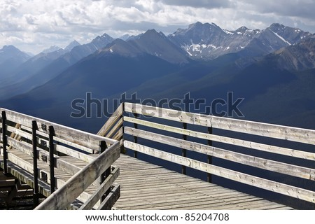 Wooden ladder with a viewing point on a mountain background