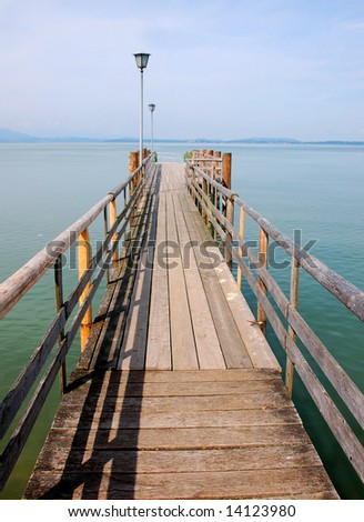 Wooden landing stage in a harbor on a lake - stock photo