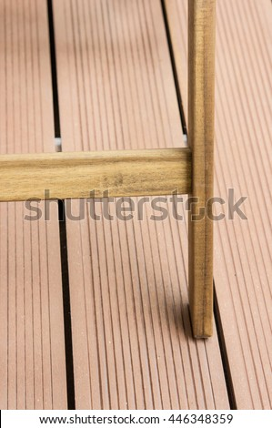 Wooden leg of a table on wooden floor