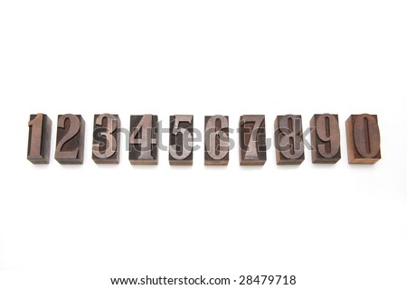 Wooden letterpress  printing blocks isolated on a white studio background.