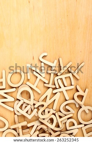 Wooden letters and numbers laid out in a row - stock photo