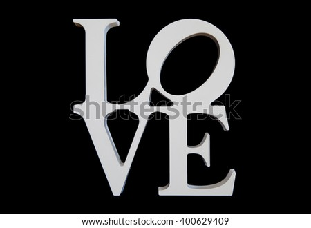 wooden letters word love on black wooden background