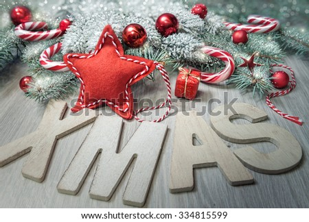 """Wooden letters """"Xmas"""" and winter decorations in red, beige and green. Merry Christmas! - stock photo"""