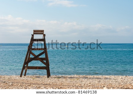 Wooden lifeguard seat facing the ocean, copy space available - stock photo