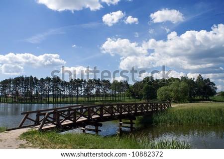 Wooden little bridge in a park - stock photo