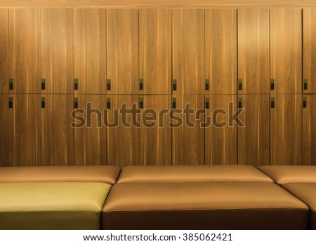 Wooden lockers and bench - stock photo