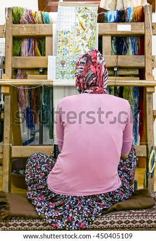 wooden loom with weaver - Turkey - stock photo