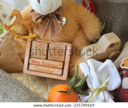"Wooden made calendar with an inscription:""December 25. Merry Christmas!!!"" - stock photo"