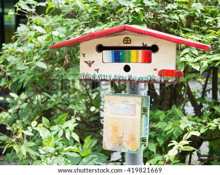 Wooden mail box in asian - stock photo