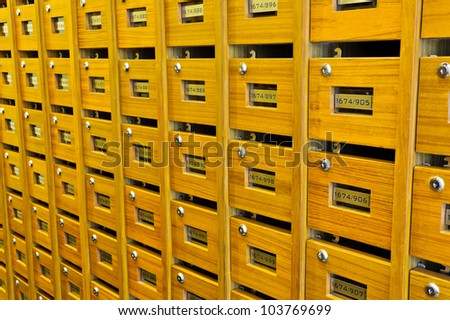 Wooden mailboxes inside apartment - stock photo
