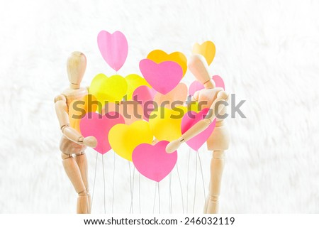 Wooden, male, female, are embracing the heart of all colors, background colors, Cream - stock photo