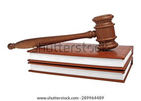 Wooden mallet and books on a white background - stock photo