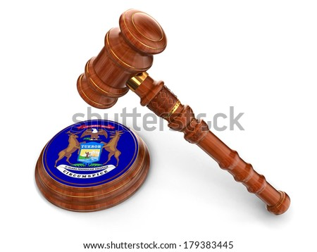 Wooden Mallet and flag Of Michigan (clipping path included) - stock photo
