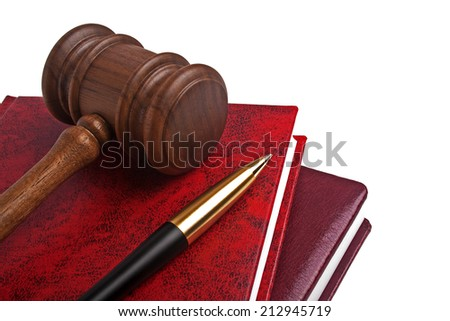 Wooden mallet, book and pen on a white background - stock photo
