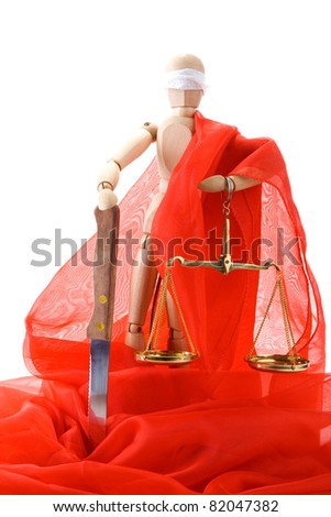 Wooden mannequin, a knife and scales on white background. The joke on the theme of Themis - Greek Goddess of Justice - stock photo