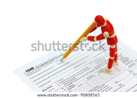 Wooden mannequin completing the 1040 Tax form for individuals