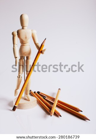Wooden mannequin for painting with pencils on a white background with a falling shade - stock photo