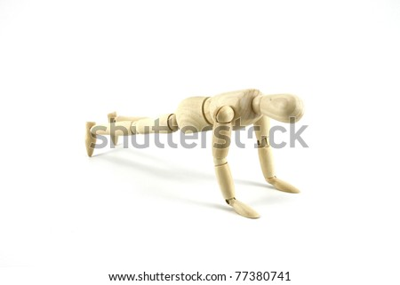 Wooden Mannequin in exercise isolated on white - stock photo
