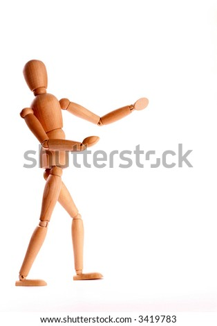 wooden mannequin introducing a product - stock photo