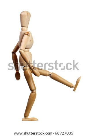 Wooden mannequin kicking isolated on white background