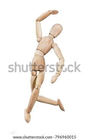Wooden mannequin trying to represent human movements in moving actions isolated on a white background. Anatomical model jumps like ballet dancer.