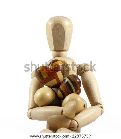 Wooden mannequin whit wood hearts - stock photo