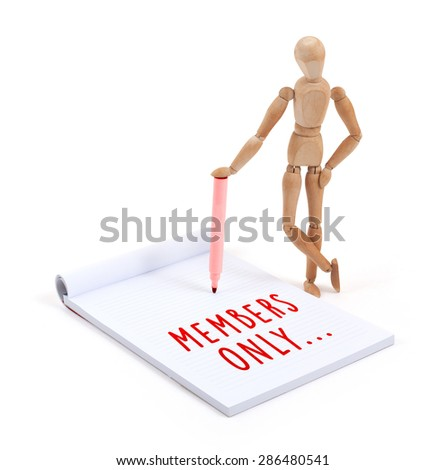 Wooden mannequin writing in a scrapbook - Members only - stock photo