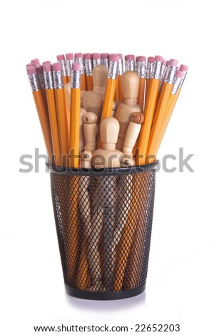 Wooden mannequins in a black metal pencil cup with many yellow pencils.  Conceptual image for office staff; workforce; secretarial; employment, etc. - stock photo