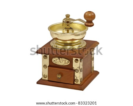 Wooden manual coffee grinder isolated on a white background.