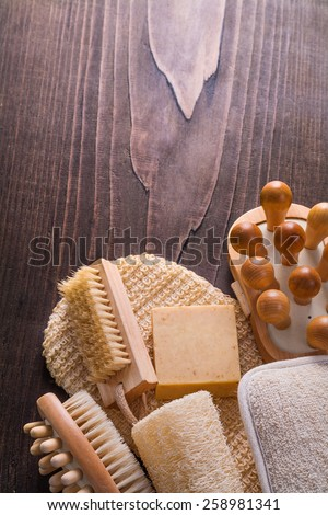 wooden massager nail brush loofah bar soap wisp on vintage wooden board with copyspace  - stock photo