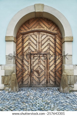 Wooden massive door in an ancient fortress Europe. - stock photo
