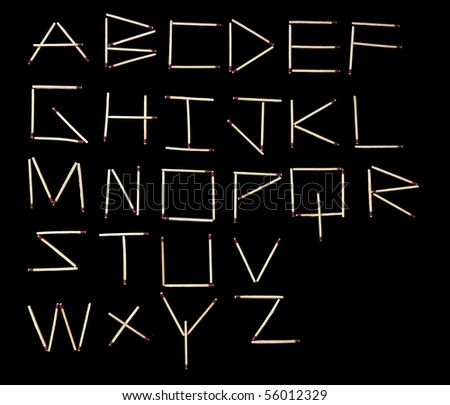 Wooden matches arranged in the alphabet isolated on black background - stock photo