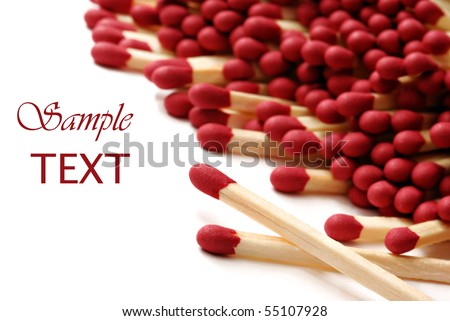 Wooden matches on white background with copy space.  Macro with extremely shallow dof. - stock photo