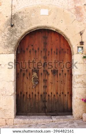 Wooden medieval style front door - stock photo