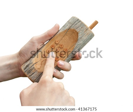 Wooden mobile phone in hands isolated on the white - stock photo