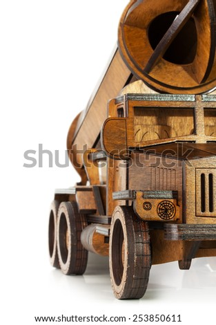 wooden model of car with rocket isolated on the white background