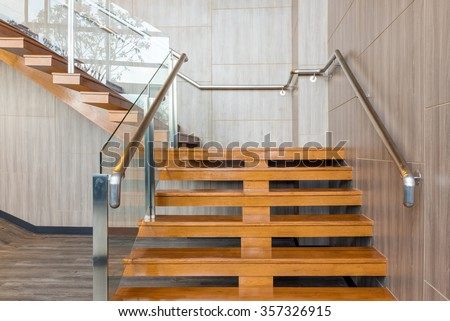 Wooden modern stairs design with aluminium handle - stock photo