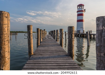 Wooden mole with Lighthouse in background at Lake Neusiedl Austria . - stock photo