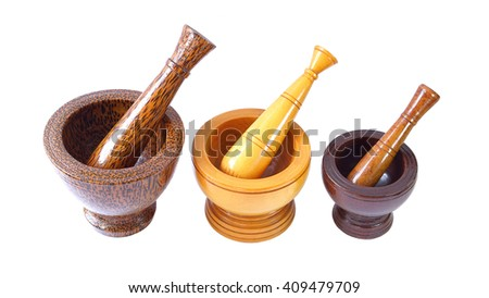 Wooden mortar and pestle on white background