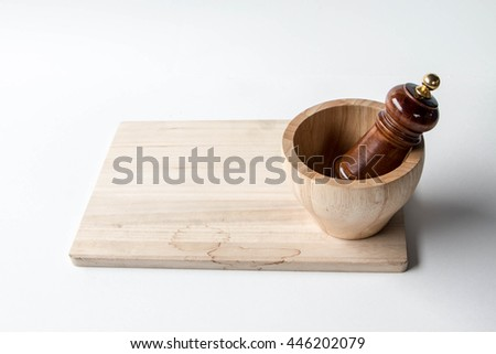 Wooden mortar and pestle on white background - stock photo