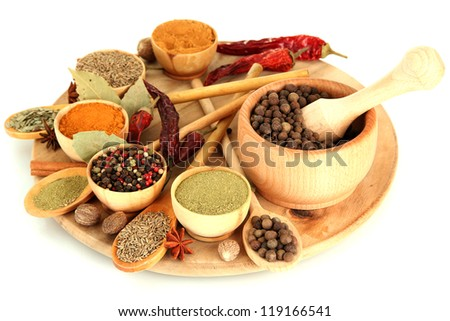 wooden mortar, bowls and spoons with spices isolated on white - stock photo