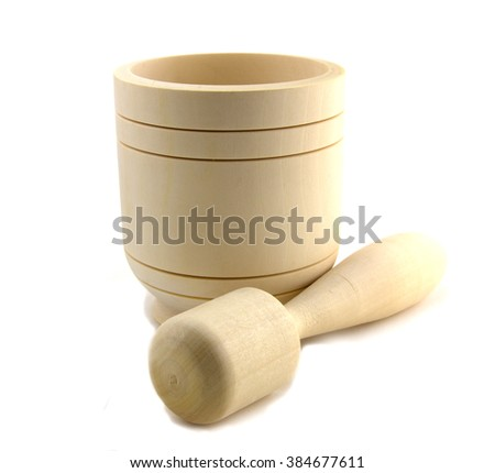 Wooden mortar with pestle standing isolated on white background