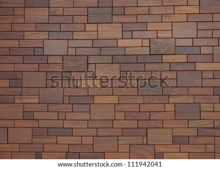 wooden mosaic wall - stock photo